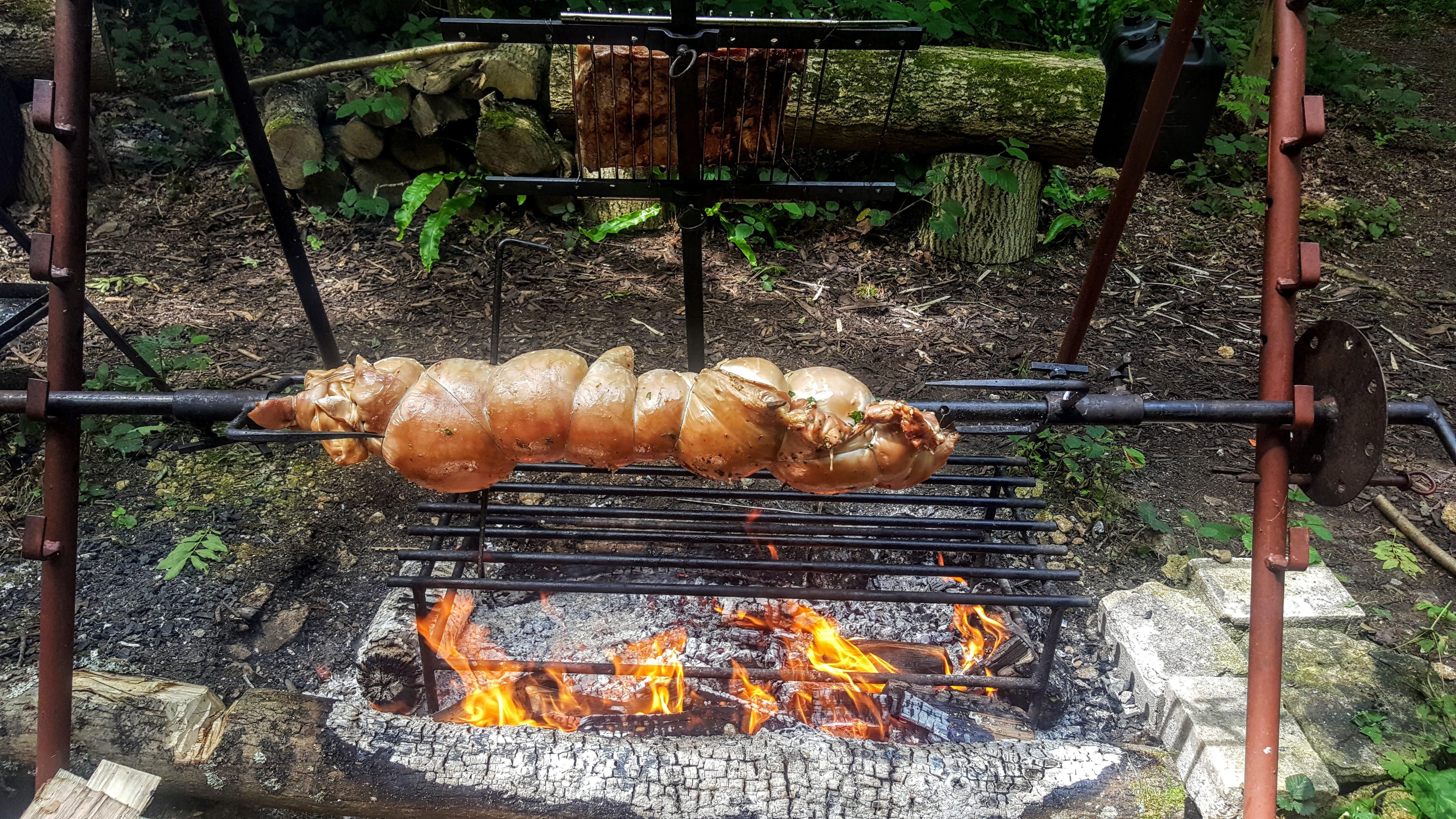 Slow roast suckling pig - porchetta style herb stuffed