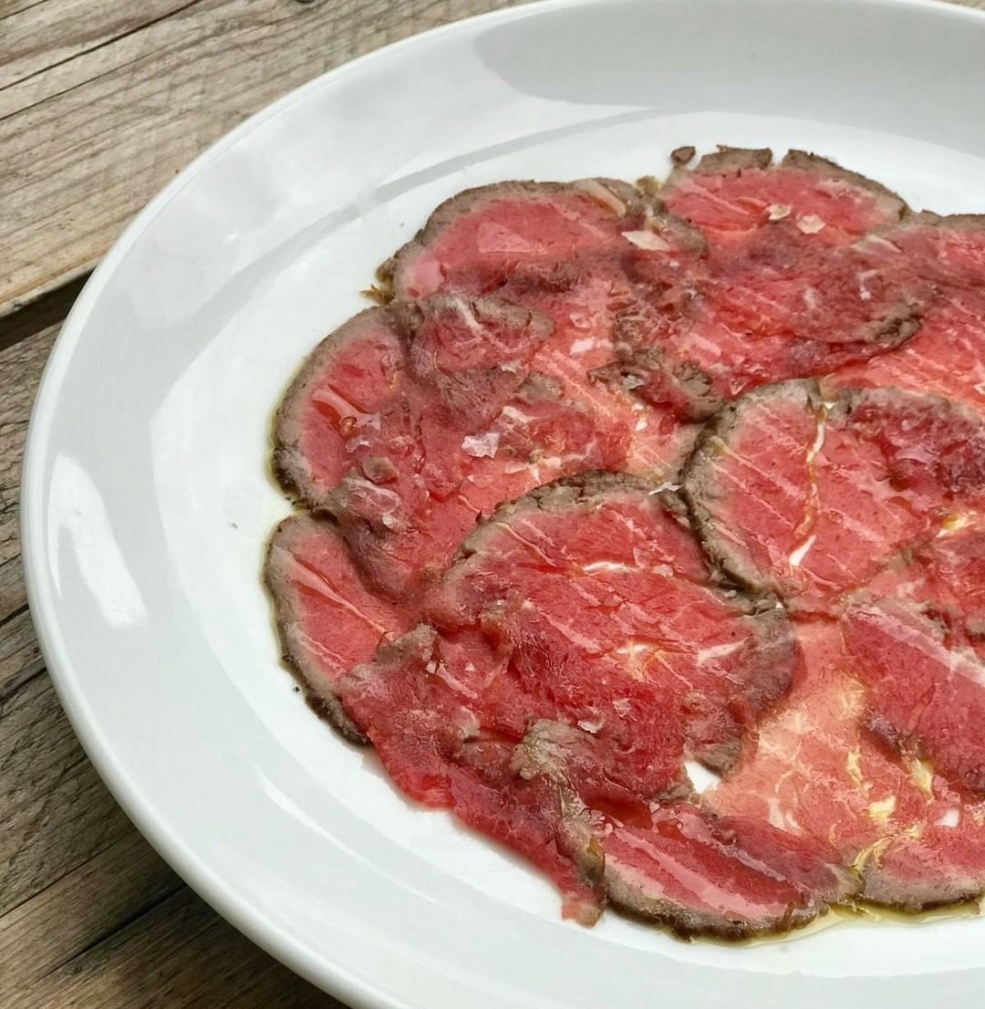 From the half cow we bought recently, this delicious peppered beef carpaccio just needs a garnish. What shall we put with it? #corkagebath #batheats